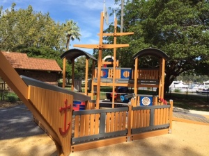 Climbing frame, slide and games within the pirate ship